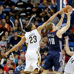 Nov 2, 2013; New Orleans, LA, USA; New Orleans Pelicans power forward Anthony Davis (23) blocks a shot by Charlotte Bobcats power forward Cody Zeller (40) during the first half of a game at New Orleans Arena. Mandatory Credit: Derick E. Hingle-USA TODAY Sports