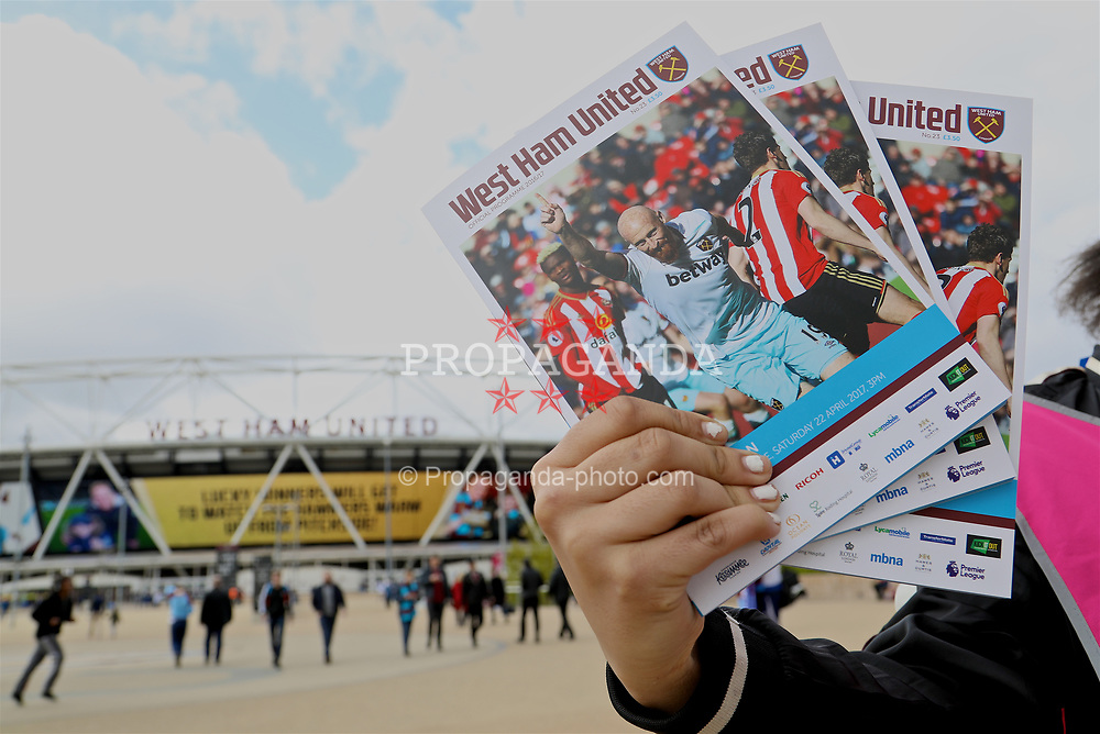 LONDON, ENGLAND - Saturday, April 22, 2017: A woman sells matchday programmes outside the London Stadium, home of West Ham United, pictured before the FA Premier League match against Everton. (Pic by David Rawcliffe/Propaganda)