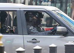 © Licensed to London News Pictures. 06/02/2017. London, UK.  Counter Terrorist Specialist Firearms Officers (CTSFO) looks out from a vehicle as Israeli Prime Minister Benjamin Netanyahu arrives at Downing Street in London for a meeting with British Prime Minister Theresa May. Photo credit: Ben Cawthra/LNP