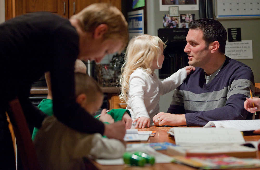 Windsor, Ontario ---11-12-16--- Essex Conservative MP Jeff Watson talks with his youngest Ava, 4, as his wife Sarah helps the other children with their schoolwork in their Amherstburg, Ontario home December 16, 2011 . Watson advocates for a national adoption strategy, and is working in Parliament for more uniform national policies around adoptive practices and tax supports.<br /> GEOFF ROBINS Toronto Star