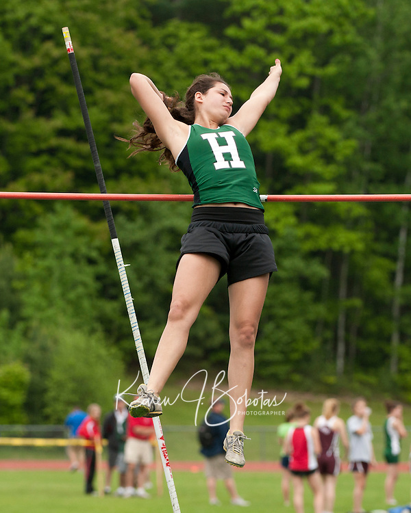 Erin Bostic of Hopkinton competes in the pole vault for the NHIAA Division III State Track Championships Saturday at Newfound High School.  (Karen Bobotas/for the Concord Monitor)