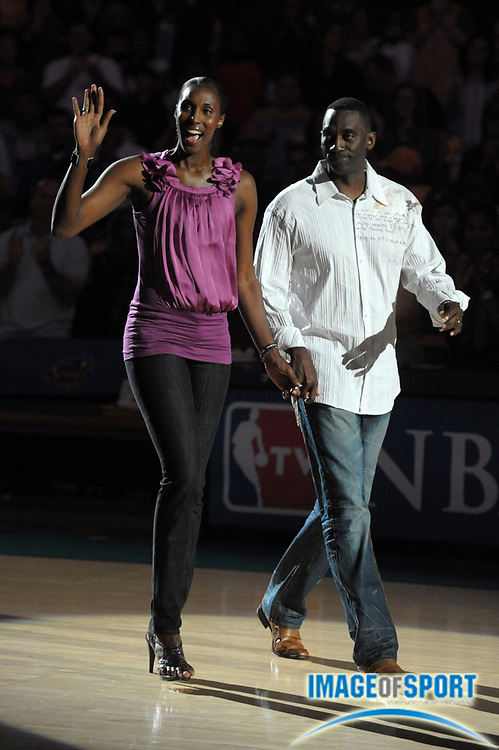 Aug 9, 2010; Los Angeles, CA, USA; Los Angeles Sparks former player Lisa Leslie (right) is accompanied by her husband Michael Lockwood during a halftime ceremony to retire the No. 9 jersey of Leslie during the WNBA game against the Indiana Fever at the Staples Center. Photo by Image of Sport