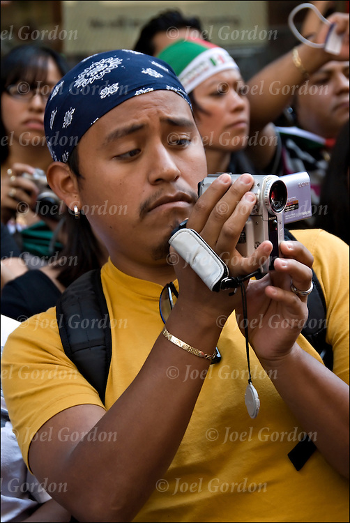 Mexican Americans photographing video recording of the Mexican Day Parade and showing ethnic pride