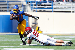 September 24, 2011; San Jose, CA, USA;  San Jose State Spartans running back Brandon Rutley (9) is tackled by New Mexico State Aggies defensive end David Niumatalolo (90) during the first quarter at Spartan Stadium.