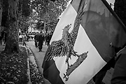 An Italian flag with a fascist eagle is seen during the march. About 2000 fascists gathered in Predappio, Italy to commemorate the annivrsary of the 'Marcia su Roma' A march held on October 28th 1922 and marked the start of the Italian fascist era. Federico Scoppa
