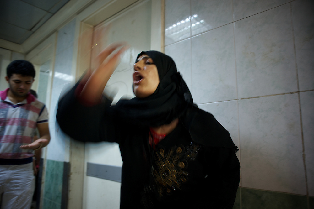 August 10, 2012 - Aleppo, Syria: A syrian woman reacts in shock to the death of a family member, killed minutes after heavy shelling from the Syrian Army against a bakery in the residential area of Tariq Al-Bab in central Aleppo. At least 12 people have died and more the 20 got injured during the attack...The Syrian Army have in the past week increased their attacks on residential neighborhoods where Free Syria Army rebel fights have their positions in Syria's commercial capital, Aleppo. (Paulo Nunes dos Santos/Polaris)