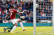 Matt Ingram of Wycombe Wanderers (green) can't prevent the ball crossing the line under pressure from Emile Sinclair of Northampton Town after spilling the ball to gift Northampton town the lead to make it 0-1 during the Sky Bet League 2 match at Adams Park, High Wycombe<br /> Picture by David Horn/Focus Images Ltd +44 7545 970036<br /> 18/04/2014