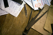 Calipers and measurements on a desk in the studio of the Stpathy family of idol makers in Swamimalai, India.The current Stpathy family is the twenty third generation of bronze casters dating back to the founding of the Chola Empire. The Stapathys had been sculptors of stone idols at the time of Rajaraja 1 (AD985-1014) but were called to Tanjore to learn bronze casting. Their methods using the 'lost wax' process remains unchanged to this day.