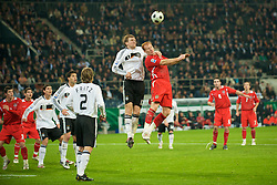 MONCHENGLADBACH, GERMANY - Wednesday, October 15, 2008: Wales' James Collins and Germany's Per Mertesacker during the 2010 FIFA World Cup South Africa Qualifying Group 4 match at the Borussia-Park Stadium. (Photo by David Rawcliffe/Propaganda)