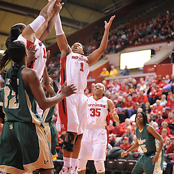 Jan 31, 2009; Piscataway, NJ, USA; Rutgers guard Khadijah Rushdan (1) and center Kia Vaughn (15) reach for an offensive rebound during the second half of South Florida's 59-56 victory over Rutgers in NCAA women's college basketball at the Louis Brown Athletic Center