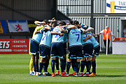 Crawley Town players huddle before kick off during the EFL Sky Bet League 2 match between Exeter City and Crawley Town at St James' Park, Exeter, England on 19 April 2019.