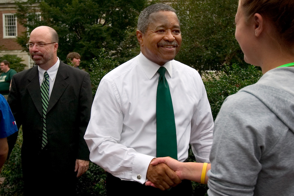"Ohio University President Roderick McDavis greets members of the 2006 freshman class as they file through the College Gate...OPENING SCHOOL IN STYLE -- Members of the 2006 freshman class at Ohio University will get their college careers off on the right foot, both literally and figuratively, with the traditional march through the College Gate at approximately 3:15 p.m. Monday, Sept. 4. Following the President's Convocation at 2:30 p.m. in the Convocation Center, the new Bobcats will follow ""The Most Exciting Band in the Land,"" the Marching 110, from the Convo for the trek up Richland Avenue toward the College Green as they officially begin their college careers..Once on the College Green, representatives of more than 200 student organizations across campus will have displays set up to introduce the newest Ohio University students to the many ways to become actively involved in campus life..It is a colorful tradition that captures the spirit of college life. It also makes for tremendous photo and video opportunities for a unique twist on the conventional moving-in activities as the academic years of schools, colleges and universities across the state hit full stride over Labor Day Weekend."