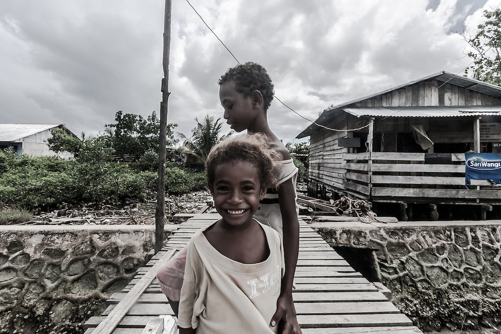 Where; Papua, Indonesia. What a cute smile!