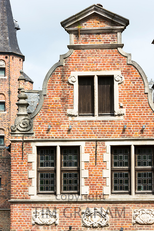 Belgian architecture of brick built building with traditional gable and leaded light windows in Bruges, Belgium