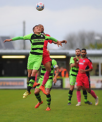 Forest Green Rovers's Elliott Frear and Dover Athletic's Ricky Modeste challenge for the high ball.  - Photo mandatory by-line: Nizaam Jones - Mobile: 07966 386802 - 25/04/2015 - SPORT - Football - Nailsworth - The New Lawn - Forest Green Rovers v Dover - Vanarama Conference League