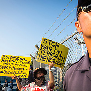 OKINAWA, JAPAN - AUGUST 19 : Anti U.S base protester holds a placards to protest against the construction of helipads in front of the main gate of U.S. military's Northern Training Area in the village of Higashi, Okinawa Prefecture, on August 19, 2016. Japanese government resume construction of total six helipads in a fragile ten million year old Yanbaru forest that is home to endemic endangered species such as the Okinawan rail and Okinawa wood pecker. (Photo by Richard Atrero de Guzman/NURPhoto)