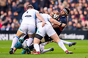 Viliame Mata (#8) of Edinburgh Rugby is tackled by Oli Kebble (#1) and Zander Fagerson (#3) of Glasgow Warriors during the 1872 Cup second leg Guinness Pro14 2019_20 match between Edinburgh Rugby and Glasgow Warriors at BT Murrayfield Stadium, Edinburgh, Scotland on 28 December 2019.