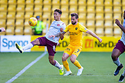 Sean Clare (#8) of Heart of Midlothian FC gets to the ball ahead of Keaghan Jacobs (#7) of Livingston FC during the Ladbrokes Scottish Premiership match between Livingston FC and Heart of Midlothian at the Tony Macaroni Arena, Livingston, Scotland on 26 October 2019.