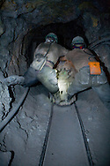 Miners working inside the mine shafts of Cerro Rico in Potosi, Bolivia.