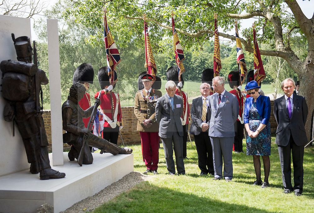 © London News Pictures. 17/06/2015. BELGIUM. <br /> His Royal Highnesses The Prince of Wales unveils a new bronze sculpture featuring two British soldiers, by Vivienne Mallock, which was unveiled as a new memorial to all the British dead. 200 years since the eve of the Battle of Waterloo, Their Royal Highnesses The Prince of Wales and the Duchess of Cornwall attended a special ceremony at Hougoumont Farm, the Belgian Farm Wellington claimed was instrumental in his victory.  Photo credit: Sergeant Rupert Frere/LNP