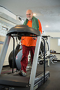 YMCA member Steve Wolotsky works out in the facilty in his Lakewood apartment building on Wednesday, March 12, 2014.