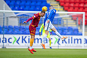 Tom Aldred (#5) of Motherwell FC wins a header against Michael O'Halloran (#17) of St Johnstone FC during the Ladbrokes Scottish Premiership match between St Johnstone and Motherwell at McDiarmid Stadium, Perth, Scotland on 11 May 2019.