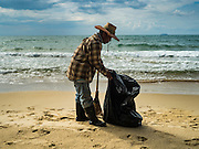 17 JANUARY 2016 - KLEANG, RAYONG, THAILAND:  A worker cleans up Laem Mae Phim Beach in Rayong province of Thailand. The beach is on the Gulf of Siam.          PHOTO BY JACK KURTZ