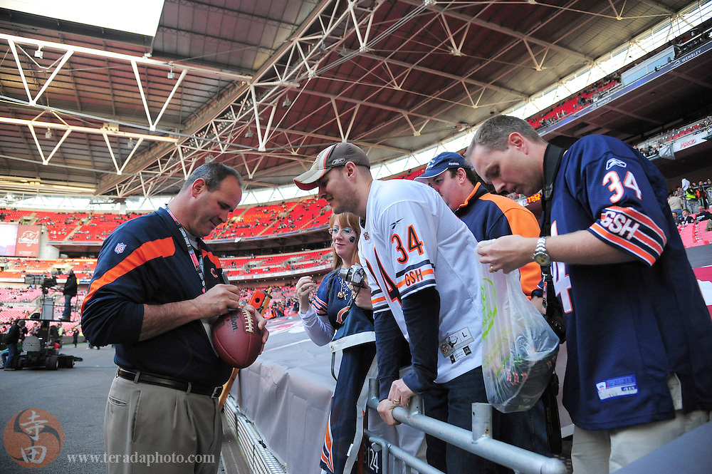 October 23, 2011; London, ENGLAND; Chicago Bears offensive line coach Mike Tice signs autographs prior to the game against the Tampa Bay Buccaneers in the NFL International Series game at Wembley Stadium.