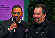 """Terrence Jenkins presents  raffle winner Dennis Van Tine his Le Bournadin certificate at the """"Share, Love, Celebrate the Best of P&G"""" Influencer Event at DIA in New York City, New York on March 27, 2013."""