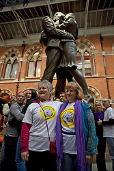 © Licensed to London News Pictures. 19/01/2012. London, U.K..world's Longest marathon hug attempt at St. Pancras station, London. To celebrate National Hugging Day (21 January) and to signal welcoming the world to London in 2012, London is aiming to break the Guinness World Records title for the world's Longest marathon hug..Photo credit : Rich Bowen/LNP