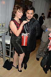 KATHY LETTE and PABLO GANGULI at the Liberatum Cultural Honour For Sir Terence Conran Dinner held at the Sanderson Hotel, Berners Street, London on 19th November 2013.
