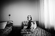 On April 26 - 2011.25 years after the Chernobyl disaster people are still suffering from the long term consequences of a nuclear meltdown. Countries affected struggle with cronic illness, contaminated food - For many their life ended with Chernobyl...<br /> At the Clinical Radiology institute in Kiev, a young girl sits in her room waiting to go for her morning treatment due to her cronical health problem related to the Chernobyl disaster. 25 years after the nuclear disaster at the Chernobyl power plant in Ukraine, the country are still suffering from sickness and pollution. children in the villages like Drosdyn suffer from general bad health and are admitted to hospitals in the capitol Kiev.