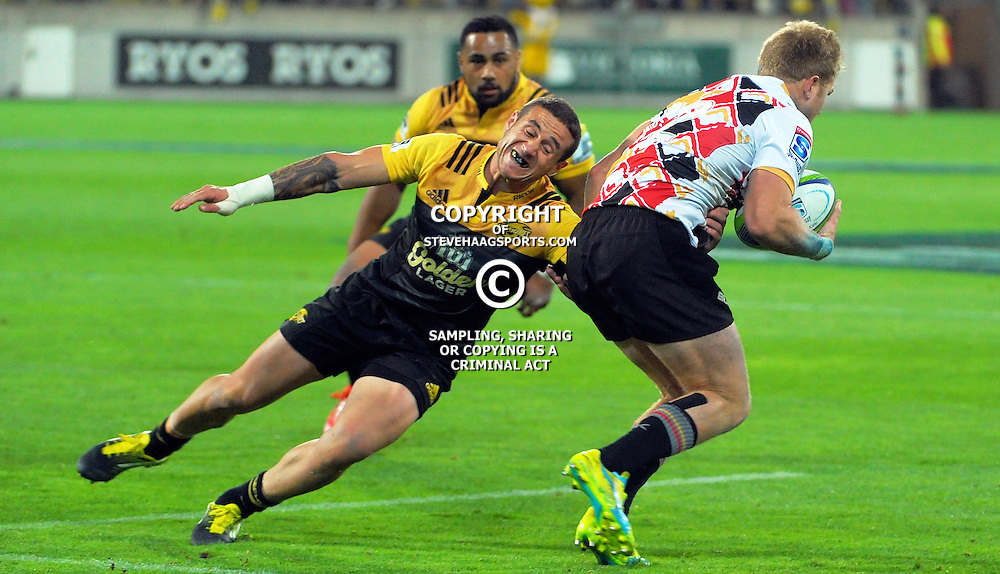 TJ Perenara tries to tackle Shane Gates during the Super Rugby match between the Hurricanes and Southern Kings at Westpac Stadium, Wellington, New Zealand on Friday, 25 March 2016. Photo: Dave Lintott / lintottphoto.co.nz