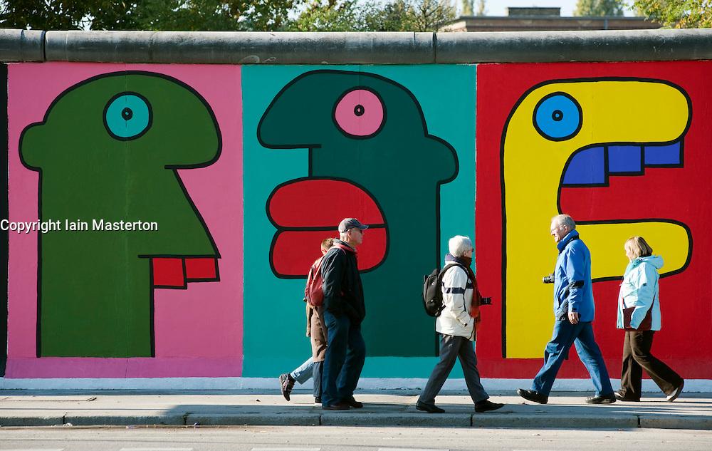 newly repainted murals on Berlin Wall at the East Side Gallery in Kreuzberg Berlin