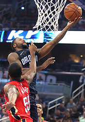December 22, 2017 - Orlando, FL, USA - The Orlando Magic's Jonathon Simmons scores over the New Orleans Pelicans' E'Twaun Moore (55) at the Amway Center in Orlando, Fla., on Friday, Dec. 22, 2017. (Credit Image: © Stephen M. Dowell/TNS via ZUMA Wire)