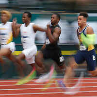 North Carolina A&T's Christopher Belcher, right, ran a 9.93 to win his heat in the men's 100 meter on the first day of the NCAA college track and field championships in Eugene, Ore., Wednesday, June 7, 2017. (AP Photo/Timothy J. Gonzalez)