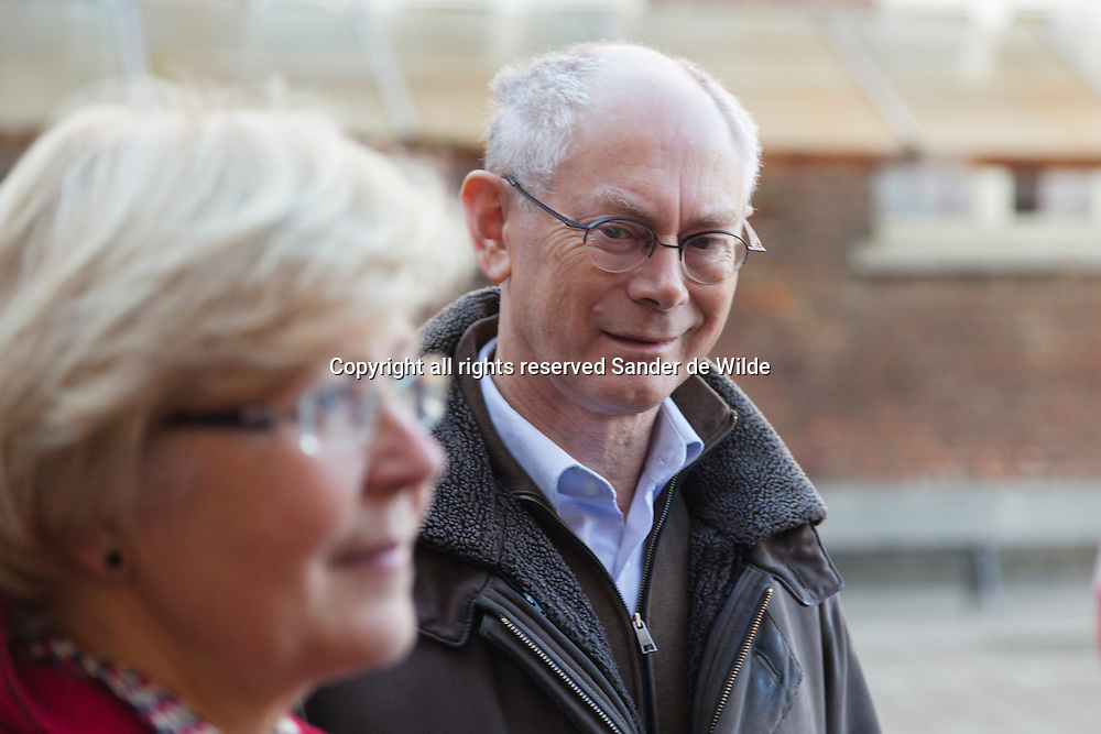 Brussels 2012 14 october. Belgian municipal elections. Mr Herman Van Rompuy  (president of the European Council) and mrs Van Rompuy ( Geertrui Windels) admires his wife giving an interview after voting. Mrs Van Rompuy is on the list of the CD&V, a Christian Democratic party, using her maiden name Geertrui Windels. Geertrui Van Rompuy-Windels