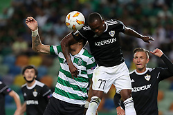 September 20, 2018 - Lisbon, Portugal - Qarabag's defender Donald Guerrier (C ) heads the ball with Sporting's defender Sebastian Coates from Uruguay during the UEFA Europa League Group E football match Sporting CP vs Qarabag at Alvalade stadium in Lisbon, on September 20, 2018. (Credit Image: © Pedro Fiuza/NurPhoto/ZUMA Press)