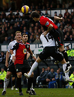 Photo: Steve Bond/Sportsbeat Images.<br /> Derby County v Blackburn Rovers. The FA Barclays Premiership. 30/12/2007. Ryan Nelson (R) outjumps Kenny Miller (14)