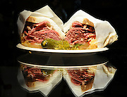 preparing a Kosher New York deli-style corned beef sandwich The finished sandwich wrapped on grease proof paper and ready to eat