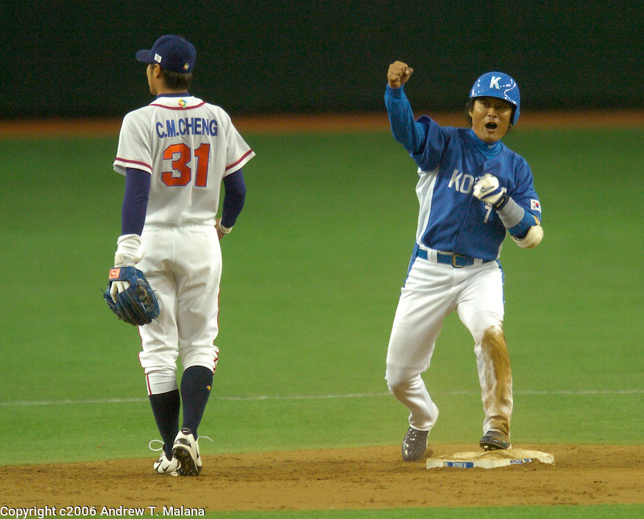 Team Korea's Jong Beom Lee pumps his fist after an RBI double in the 5th inning against Chinese Taipei in the opening game of the World Baseball Classic at Tokyo Dome, Tokyo, Japan.