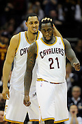 Feb. 11, 2011; Cleveland, OH, USA; Cleveland Cavaliers center Ryan Hollins (5) and power forward J.J. Hickson (21) celebrates after scoring during the fourth quarter at Quicken Loans Arena. The Cavaliers broke their loosing streak beating the Clipper 126-119 in overtime. Mandatory Credit: Jason Miller-US PRESSWIRE