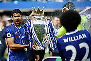 Chelsea Forward Diego Costa (19) celebrates with the trophy during the Premier League match between Chelsea and Sunderland at Stamford Bridge, London, England on 21 May 2017. Photo by Andy Walter.