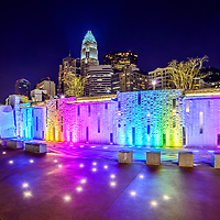 Charlotte skyline at night with Romare Bearden Park colorful wall lights. Charlotte is a major city in North Carolina in the Eastern United States of America.