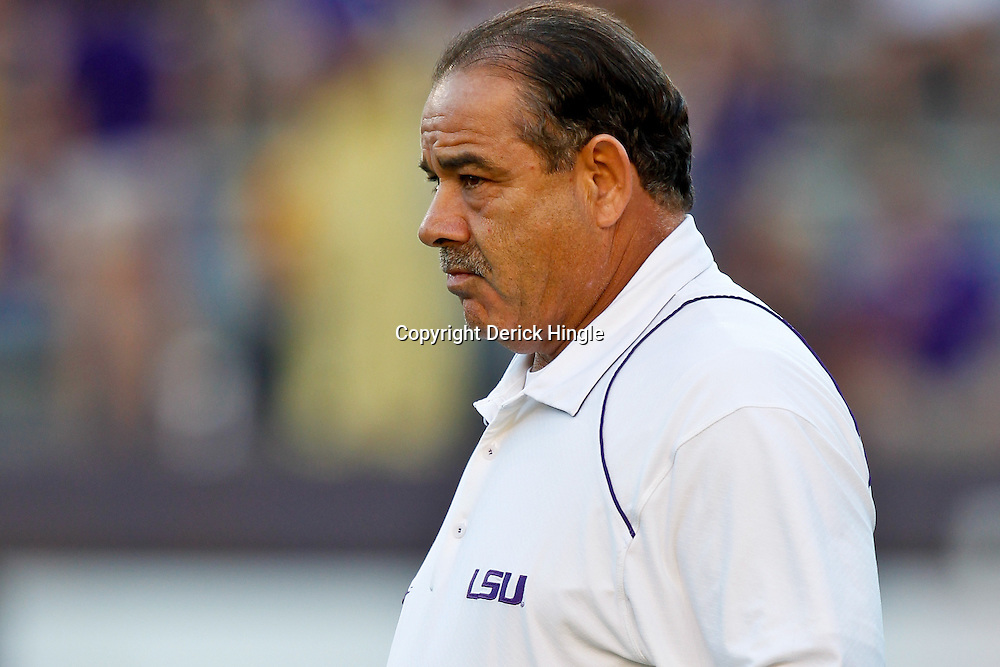 October 16, 2010; Baton Rouge, LA, USA; LSU Tigers defensive coordinator John Chavis watches during warm ups prior to kickoff of a game against the McNeese State Cowboys at Tiger Stadium.  Mandatory Credit: Derick E. Hingle