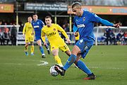 AFC Wimbledon defender Rod McDonald (4) passing the ball into the box during the EFL Sky Bet League 1 match between AFC Wimbledon and Fleetwood Town at the Cherry Red Records Stadium, Kingston, England on 8 February 2020.