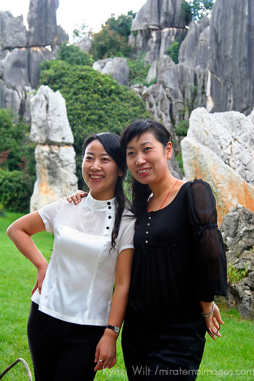 Asia, China, Kunming. Chinese visitors to the Stone Forest in Kunming.