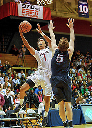 MOON TOWNSHIP, PA - NOVEMBER 11:  Isaiah Still #1 of the Robert Morris Colonials goes to the basket against Jackson Donahue #5 of the Pennsylvania Quakers in the second half during the game on November 11, 2016, at the Charles L. Sewall Center in Moon Township, Pennsylvania. (Photo by Justin Berl)