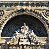 Lady Justice Statue on Palace of Justice in Rome, Italy <br /> Most depictions of Lady Justice portray her with a blindfold and holding a double-edged sword in the right hand and scales dangling from the left.  However, beneath the central arch on the Palace of Justice&rsquo;s facade in this sculpture of lustitia, which is Latin for Justice, it shows the Roman goddess with the sword but holding a book of law on the left. Look closely and you&rsquo;ll also see two images of the she-wolf that nursed Romulus and Remus, the twins who founded Rome.  Typically this iconic Roman image shows the infants together yet here they are apart, perhaps alluding to their quarrel and the subsequent murder of Remus.