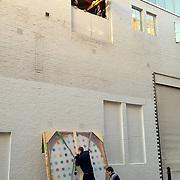 2012011601-Gallery installing Damien Hirst artwork